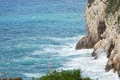 pic of cliffs moher  - Waves hitting cliff in Ireland near ocean - JPG