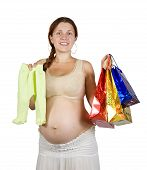 image of babygro  - pregnant woman with shopping bags and baby - JPG