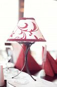 foto of lamp shade  - White lamp with red patterns on a table - JPG