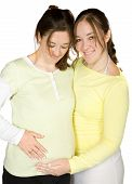 picture of pregnant woman  - pregnant woman and her sister over white - JPG