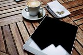 stock photo of blank check  - Wooden table with empty blank screen tablet cup of coffee and bill check with money business work break - JPG