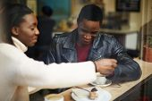 stock photo of san valentine  - Two young friends talk and drink coffee in cafe good friends good friends enjoying coffee in beautiful place cold winter days indoors - JPG