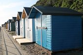 stock photo of beach hut  - A Row of Wooden Beach Huts at the Seaside - JPG