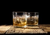 picture of scotch  - Glasses of scotch on wooden and black background with copyspace - JPG
