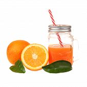 stock photo of masonic  - Orange jues in a mason jar glass with striped straw and fresh fruit slices isolated on white background - JPG