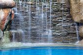 stock photo of waterfalls  - waterfall decorate in the pool and blue water tone - JPG