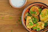 stock photo of baked potato  - Baked potatoes with herb - JPG