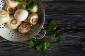 picture of champignons  - Fresh white champignons on dark wooden table - JPG