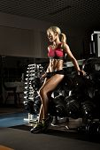 pic of execution  - beautiful girl bodybuilder execute exercise with weight - JPG