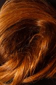 stock photo of hair streaks  - Red Hair over black - JPG