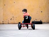 picture of pedal  - happy boy child riding a pedal cart - JPG