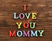 picture of mummy  - Inscription I LOVE YOU MUMMY made of colorful letters on wooden background - JPG