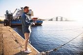 foto of street-rod  - Man casting with light rod on the river near the dock - JPG