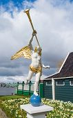 pic of angel-trumpet  - statue of an angel trumpeter in the netherlands - JPG