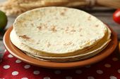 image of whole-wheat  - Stack of homemade whole wheat flour tortilla on plate - JPG