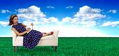 stock photo of surrealism  - black female artist with a sketchbook in a surreal outdoor setting - JPG