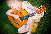 foto of singing  - Little Guitar Player - JPG