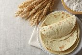 stock photo of whole-wheat  - Stack of homemade whole wheat flour tortilla on napkin - JPG