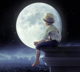 stock photo of roof-light  - Young boy on a roof - JPG