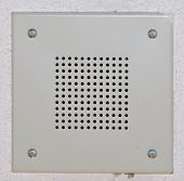pic of stippling  - Speaker grille mounted on a stippled ceiling - JPG