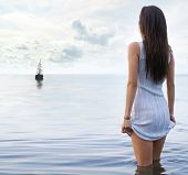 picture of beautiful lady  - Young sexy lady standing in the warm water - JPG