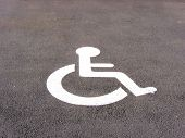 stock photo of physically handicapped  - the symbol handicapped on a parking space - JPG