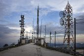 Plenty Of Radio Masts Located On The Hilltop Wit Antennas. Radio Masts And Towers Are Tall Structure poster