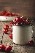 Fresh cherry on wooden background. fresh ripe cherries. sweet cherries. poster