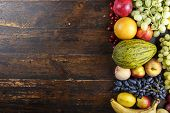 Fruit Background With Exotic Fruits On A Brown Wooden Background, Fruit Detox, Space For Text poster