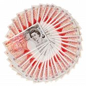stock photo of currency  - Many 50 pound sterling bank notes fanned out isolated on white - JPG