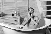 Man In The Bathroom. Sexuality And Relaxation Concept. Guy In Bathroom With Toiletries And Stairs On poster