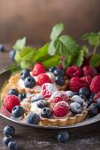 Dessert Tarts With Raspberries And Blueberries On A Wooden Table. poster
