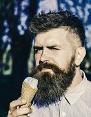 Chilling Concept. Man With Long Beard Chilling With Ice Cream Cone On Sunny Hot Day, Close Up. Man W poster