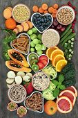 High fibre health food concept with whole wheat pasta, legumes, cereals, grains, fresh fruit & veget poster