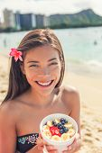 Acai bowl food healthy breakfast Asian woman eating snack on ocean background at hawaii beach. Berri poster