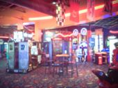 Vintage Blurred Arcade Game Room At Entertainment Complex poster