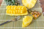 Pineapple With Slices - Fresh Of Pineapple Slices Asian-style On The Bamboo Place Mats Background. T poster