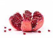 Open Pomegranate Fruit On A White Background. Pomegranate Fruit Close-up. Juicy Pomegranate In The O poster