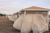 White Beach Canopies At Sunset. Luxury Beach Tents At Luxurious Beach Resort. Summer Beach Concept,  poster