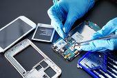 Asian Technician Repairing Micro Circuit Main Board Of Smartphone Electronic Technology : Computer,  poster