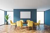 Interior Of Modern Dining Room With Blue Walls, Wooden Floor, Long Dining Table With Yellow Chairs A poster
