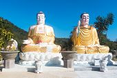 Two Giant Buddhist Statues The Backgroung Of Mountans And Sky In Asia, Vietnam, Nha Trang. 2 Buddha  poster