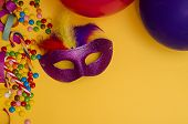 Carnival. Festive Background With Copy Space. Carnival Mask Purple With Feathers On A Yellow Backgro poster