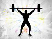 stock photo of weight lifter  - Silhouette of a weight lifter with heavy weight on colorful abstract grunge background - JPG