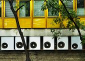 Climate Units In A Row Mounted Onto A Building Providing Good Climate. poster