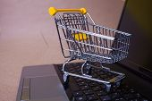 E-commerce, Concept. Online Shopping, Shopping Cart On Laptop Keyboard. Shopping In Online Stores An poster