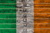 National Flag  Of Ireland On A Wooden Wall Background. The Concept Of National Pride And A Symbol Of poster