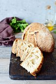 Homemade Freshly Baked Country Bread  Made From Wheat And Whole Grain Flour On A Gray-blue Backgroun poster