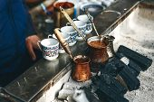 Cooking Freshly Flavored Traditional Turkish Charcoal Coffee. Traditional Turkish Cuisine. poster