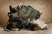 stock photo of knapsack  - Still life with an old backpack and travel accessories 